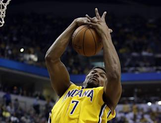 Indiana Pacers center Andrew Bynum (17) pulls down a rebound while playing the Boston Celtics during the first half of an NBA basketball game in Indianapolis, Tuesday, March 11, 2014. (AP Photo/AJ Mast)