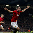 Manchester United s Robin van Persie celebrates after scoring against Arsenal during their English Premier League soccer match at Old Trafford Stadium, Manchester, England, Saturday Nov. 10, 2013