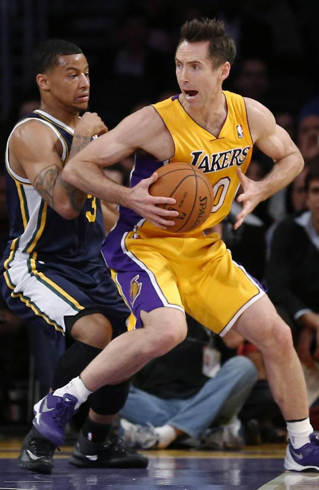 Los Angeles Lakers' Steve Nash, right, moves around Utah Jazz's Trey Burke during the first half of an NBA basketball game in Los Angeles, Tuesday, Feb. 11, 2014