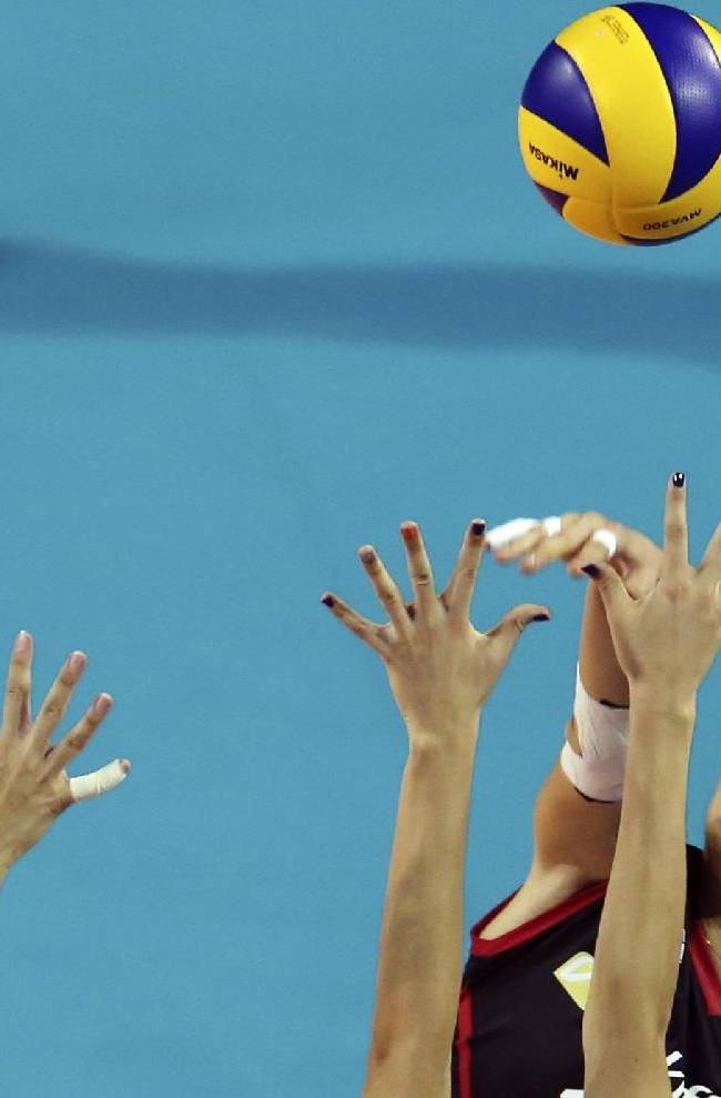 Neriman Ozsoy of Turkey spikes the ball against Russia during Women's Volleyball World Grand Prix final round ,in Tokyo, Friday, Aug. 22, 2014