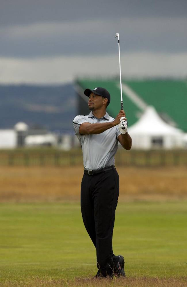 Tiger Woods of the US walks plays a shot on the 2nd fairway during a practice round at Royal Liverpool Golf Club prior to the start of the British Open Golf Championship, in Hoylake, England, Saturday, July 12, 2014. The 2014 Open Championship starts on Thursday July 17
