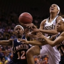 Notre Dame guard Skylar Diggins, center, is fouled while driving to the basket between Tennessee Martin's Jasmine Newsome, left, and Heather Butler, right during the second half of a first-round game in the women's NCAA college basketball tournament, Sunday, March 24, 2013, in Iowa City, Iowa. Notre Dame won 97-64. (AP Photo/Charlie Neibergall)