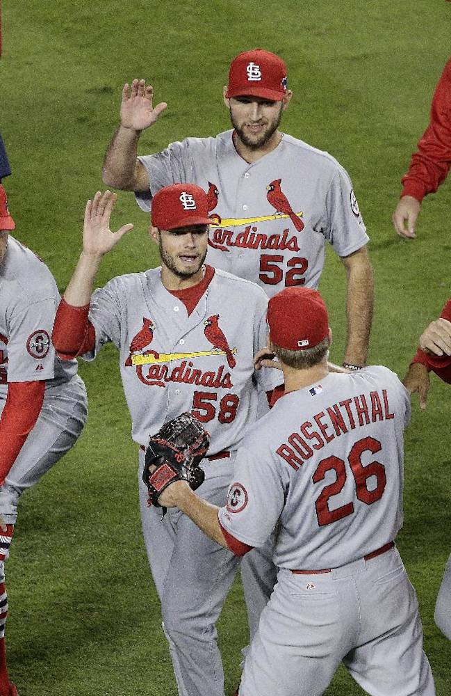 St. Louis Cardinals relief pitcher Trevor Rosenthal (26) is congratulated by teammates after Game 4 of the National League baseball championship series against the Los Angeles Dodgers Tuesday, Oct. 15, 2013, in Los Angeles. The Cardinals won 4-2 to take a 3-1 lead in the series