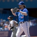 Toronto Blue Jays starting pitcher R.A. Dickey reacts as Baltimore Orioles designated hitter Danny Valencia rounds the bases on his two run homerun during third inning MLB American League baseball action in Toronto on Saturday, May 25, 2013.(AP Photo/ THE CANADIAN PRESS,Frank Gunn)