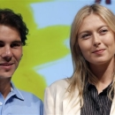 Spain's Rafael Nadal, left, and Russia's Maria Sharapova pose during the draw for the 2013 French Open tennis tournament, at Roland Garros stadium in Paris, Friday May, 24, 2013. (AP Photo/Christophe Ena)