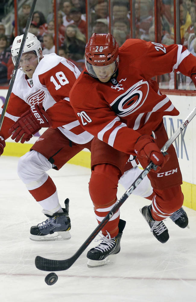 Red Wings rally to beat Hurricanes 3-2 in OT