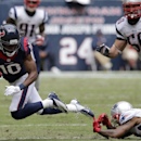 Houston Texans' DeAndre Hopkins (10) is tripped by New England Patriots' Aqib Talib, bottom right, after a reception during the second quarter of an NFL football game on Sunday, Dec. 1, 2013, in Houston The Associated Press
