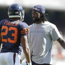 Injured Chicago Bears cornerback Charles Tillman talks to cornerback Kyle Fuller (23) in the second half of an NFL football game against the Green Bay Packers Sunday, Sept. 28, 2014, in Chicago. The Associated Press