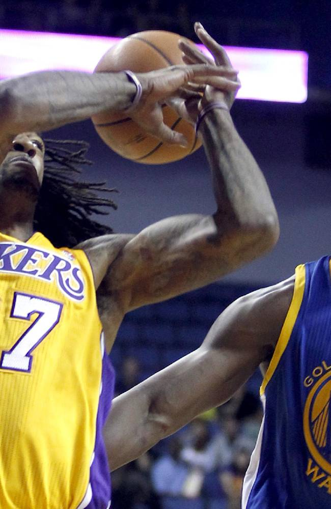 Los Angeles Lakers center Jordan Hill (27) loses the ball with Golden State Warriors forward Harrison Barnes, right, defending, in the first quarter during an NBA basketball preseason game Saturday, Oct. 5, 2013, in Ontario, Calif