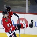 Chicago Blackhawks left wing Kris Versteeg (23) celebrates his goal against the Dallas Stars during the third period of an NHL hockey game on Sunday, Nov. 16, 2014, in Chicago. The Chicago Blackhawks won 6-2 The Associated Press