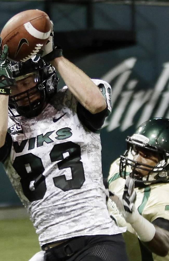 Portland State wide receiver Alex Toureen, left, hauls in a touchdown pass against Cal Poly defender Karlton Dennis during the first half of an NCAA college football game in Portland, Ore., Thursday, Sept. 26, 2013