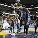 Memphis Grizzlies guard Mike Conley, center, and forward Zach Randolph (50) try to score against Charlotte Bobcats defenders Josh McRoberts (11), Michael Kidd-Gilchrist (14) and Al Jefferson (25) in the second half of an NBA basketball game Saturday, Marc