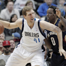 In this Feb. 26, 2014 file photo, Dallas Mavericks' forward Dirk Nowitzki (41) battles New Orleans Pelicans' Al-Farouq Aminu (0) during the second half of an NBA basketball game in Dallas. While it will take a major upset for the Mavericks to get past top