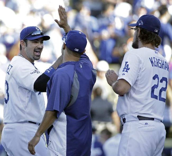Los Angeles Dodgers' Adrian Gonzalez (23) celebrates with teammates after Game 5 of the National League baseball championship series against the St. Louis Cardinals Wednesday, Oct. 16, 2013, in Los Angeles. The Dodgers won 6-4 and trail in the series 3-2