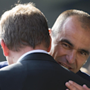 Everton's manager Roberto Martinez, right, greets Liverpool's manager Brendan Rodgers before the English Premier League soccer match between Everton and Liverpool at Goodison Park Stadium, Liverpool, England, Sunday Oct. 4, 2015. (AP Photo/Jon Sup