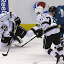 Los Angeles Kings right wing Dustin Brown, left, tries to control the puck in front of center Jordan Nolan (71) and San Jose Sharks center Logan Couture (39) during the first period of an NHL preseason hockey game in San Jose, Calif., Tuesday, Sept. 30, 2