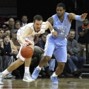 Virginia forward Evan Nolte keeps control of the ball against North Carolina guard Leslie McDonald during the first half of an NCAA college basketball game in Charlottesville, Va., Sunday, Jan. 6, 2013. (AP Photo/Norm Shafer)