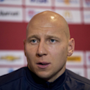 U.S. national soccer team goalkeeper Brad Guzan speaks during a press conference at Fulham's Craven Cottage stadium in London, Thursday, Nov. 13, 2014. The U.S. are due to play Colombia in an international friendly soccer match at the stadium on Friday
