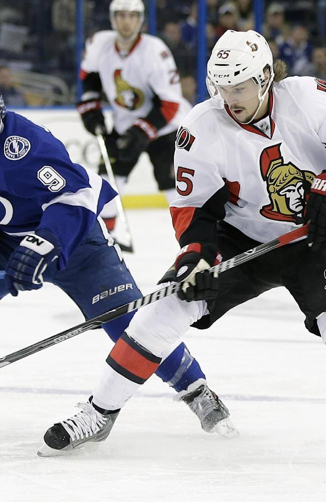Ottawa Senators defenseman Erik Karlsson (65) cuts in front of Tampa Bay Lightning center Tyler Johnson (9) during the first period of an NHL hockey game Thursday, Jan. 23, 2014, in Tampa, Fla