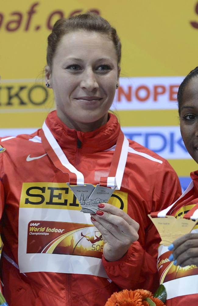 Russia's silver medal winner Anzhelika Sidorova, Czech Republic's silver medal winner Jirina Svobodova and Cuba's gold medal winner Yarisley Silva, from left, show off their medals during the ceremony for the women's pole vault at the Athletics Indoor World Championships in Sopot, Poland, Sunday, March 9, 2014