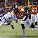 Indianapolis Colts running back Ahmad Bradshaw is knocked out of bounds by Denver Broncos free safety Rahim Moore (26) during the second half of an NFL divisional playoff football game, Sunday, Jan. 11, 2015, in Denver The Associated Press