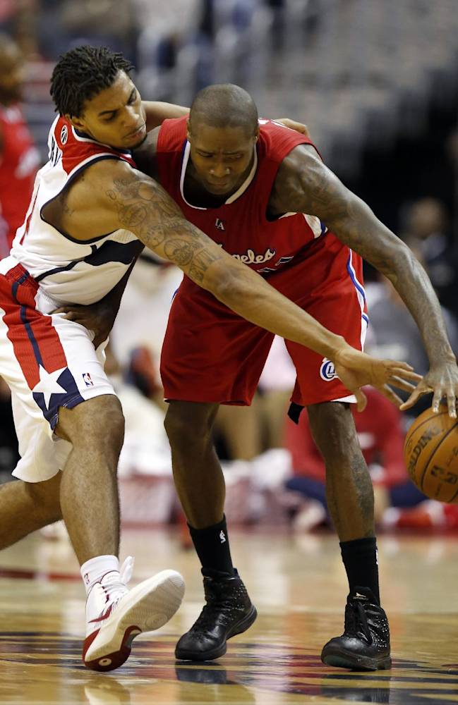 Washington Wizards guard Glen Rice Jr. (14) reaches for the ball as Los Angeles Clippers guard Jamal Crawford (11) dribbles, in the second half of an NBA basketball game, Saturday, Dec. 14, 2013, in Washington. The Clippers won 113-97