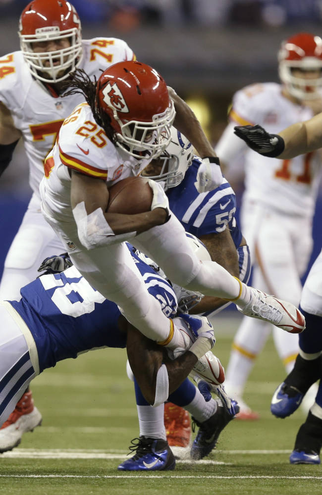 Indianapolis Colts cornerback Greg Toler (28) tackles Kansas City Chiefs running back Jamaal Charles (25) during the first half of an NFL wild-card playoff football game Saturday, Jan. 4, 2014, in Indianapolis