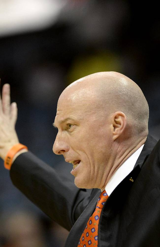 Illinois head coach John Groce calls a play against Auburn in the first half of an NCAA college basketball game on Sunday, Dec. 8, 2013, in Atlanta