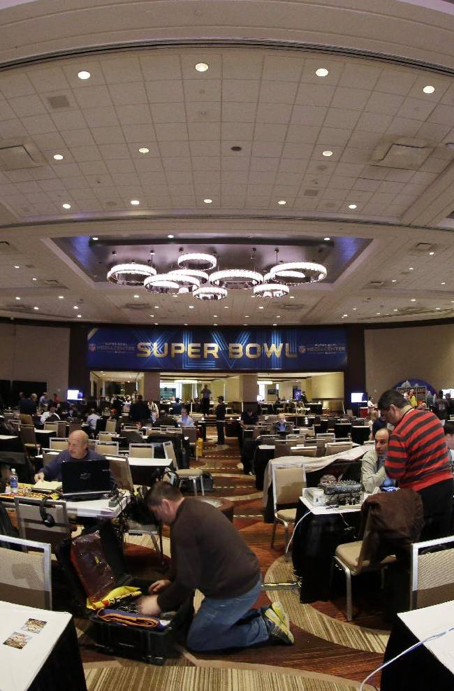 Broadcasters begin to set up on radio row at the NFL Super Bowl XLVIII media center, Monday, Jan. 27, 2014, in New York. The NFL's championship game between the Denver Broncos and Seattle Seahawks is scheduled for Sunday, Feb. 2 in East Rutherford, N.J