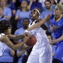 North Carolina guard Danielle Butts, left, and center Waltiea Rolle try to rebound a ball against Delaware guard/forward Elena Delle Donne during the second half of a second-round game in the women's NCAA college basketball tournament in Newark, Del., Tuesday, March 26, 2013. Delaware won 78-69. (AP Photo/Patrick Semansky)