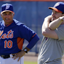 New York Mets' Daniel Murphy, right, stretches as manager Terry Collins watches during spring training baseball practice, Monday, Feb. 17, 2014, in Port St. Lucie, Fla The Associated Press