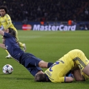 PSG's Edinson Cavani is sent flying by a challenge from Chelsea's Branislav Ivanovic, right, during the Champions League round of 16 first leg soccer match between Paris Saint Germain and Chelsea at the Parc des Princes stadium in Paris, France, Tuesday,