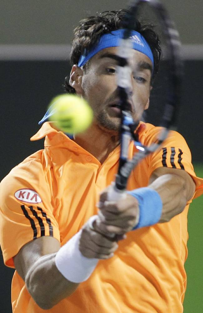 Fabio Fognini, of Italy, returns the ball to Rafael Nadal, of Spain, during the Sony Open tennis tournament, Tuesday, March 25, 2014, in Key Biscayne, Fla.  Nadal won 6-2, 6-2