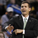 Boston Celtics coach Brad Stevens calls to his players during the first quarter of an NBA basketball game against the Philadelphia 76ers, Friday, April 4, 2014, in Boston The Associated Press