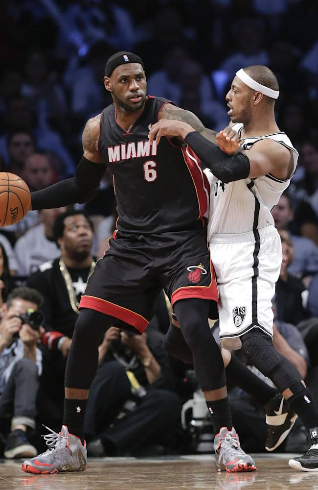 Miami Heat forward LeBron James (6) looks to drive against Brooklyn Nets forward Paul Pierce (34) in the third period during Game 3 of an Eastern Conference semifinal NBA playoff basketball game, Saturday, May 10, 2014, in New York. The Nets won 104-90