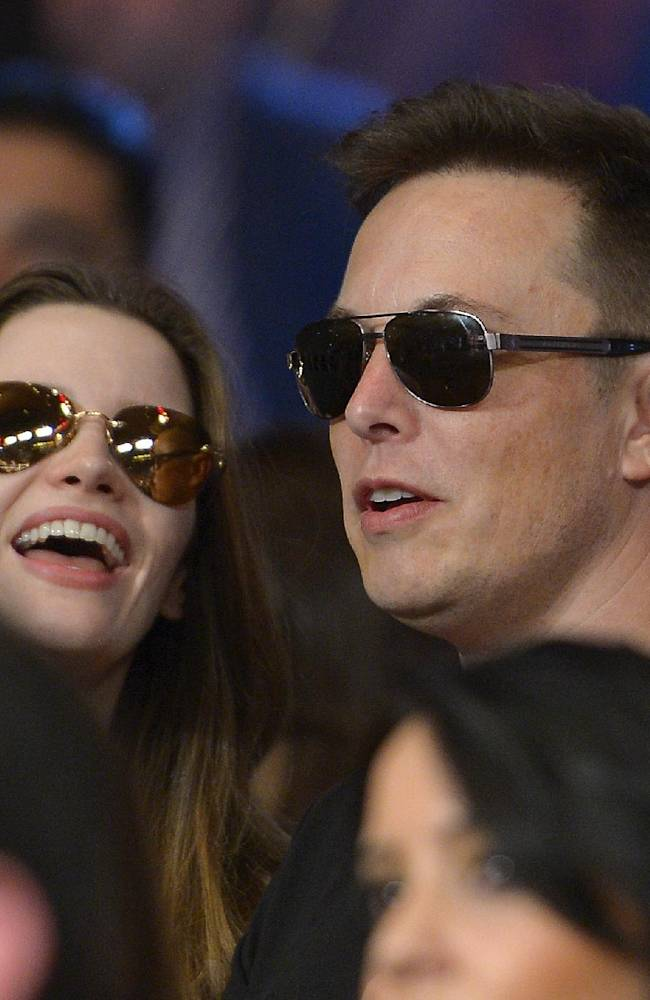 Elon Musk, right, is seen before a 152-pound title fight between Floyd Mayweather Jr. and Canelo Alvarez, Saturday, Sept. 14, 2013, in Las Vegas