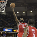 Houston Rockets guard James Harden, left, drives to the basket during the third quarter of an NBA basketball game agains the Sacramento Kings in Sacramento, Calif., Tuesday Feb. 25, 2014. Harden scored 43 points in the Rockets 129-103 victory The Associa