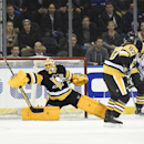 Pittsburgh Penguins center Sidney Crosby (87) watches Pittsburgh Penguins goalie Marc-Andre Fleury (29) block a shot on goal by the New York Rangers in the first period of an NHL hockey game at Madison Square Garden on Monday, Dec. 8, 2014, in New York Th