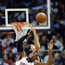 Atlanta Hawks forward Paul Millsap, foreground, and Indiana Pacers forward Luis Scola battle for a jump ball in the first half of Game 3 of an NBA basketball first-round playoff series on Thursday, April 24, 2014, in Atlanta The Associated Press