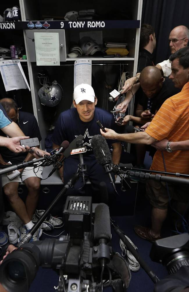 Dallas Cowboys quarterback Tony Romo speaks to reporters in the locker room after an NFL football minicamp workout Tuesday, June 17, 2014, in Irving, Texas.  Cowboys backup quarterback Kyle Orton was a no-show for the first mandatory offseason practice, with Brandon Weeden, a first-round pick by Cleveland in 2012, the No. 2 quarterback in Orton's absence
