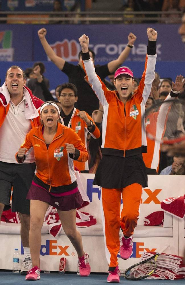 Micromax Indian Aces players from left, Fabrice Santoro, Cedric Pioline, Sania Mirza and Ana Ivanovic celebrate as their team members Gael Monfils, and Rohan Bopanna, right, beat Manila Mavericks players Treat Huey and Daniel Nestor, in men's double during International Premier Tennis League, in New Delhi, India ,Saturday, Dec. 6, 2014. (AP Photo /Manish Swarup)