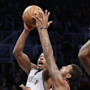 Portland Trail Blazers small forward Dorell Wright (1) defends as Brooklyn Nets shooting guard Joe Johnson (7) goes up for a layup in the first half of their their NBA basketball game at the Barclays Center, Monday, Nov. 18, 2013, in Brooklyn The Associa