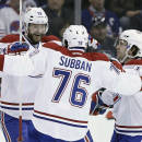 Montreal Canadiens' Andrei Markov (79). P.K. Subban (76) and David Desharnais (51) celebrate Subban's goal against the Winnipeg Jets during the second period of an NHL hockey game, Thursday, March 26, 2015 in Winnipeg, Manitoba. (AP Photo/The Canadian Press, John Woods)