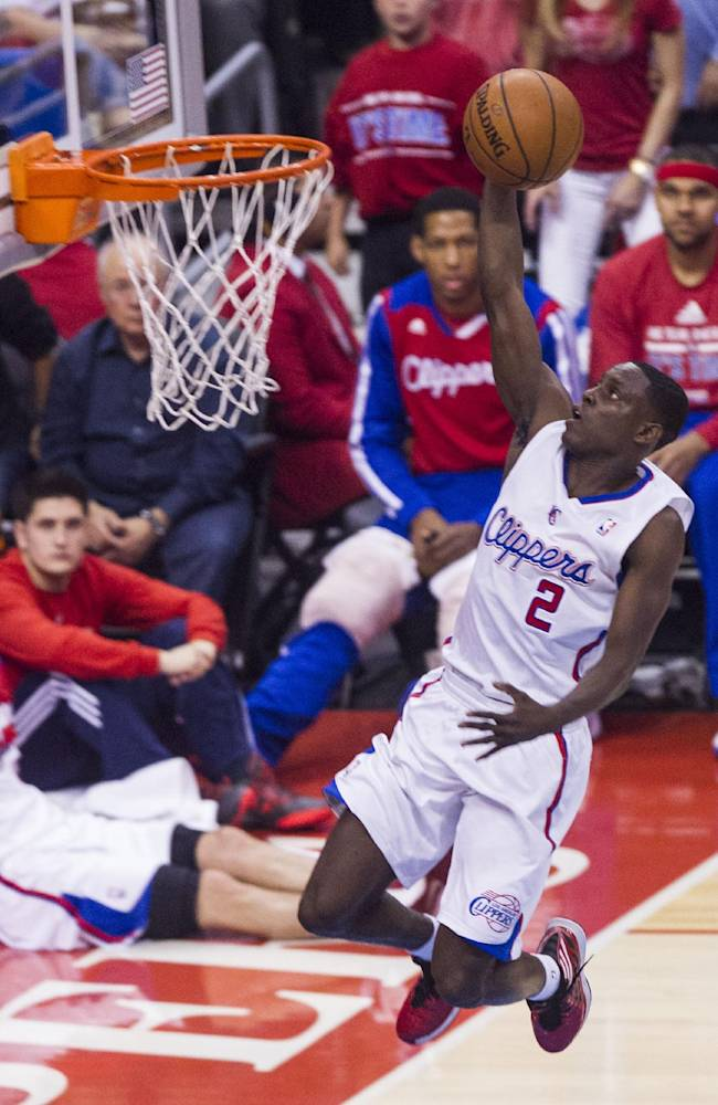 Los Angeles Clippers guard Darren Collison (2) goes up for a lay up against Golden State Warriors during the first half of Game 7 of a first-round NBA basketball playoff series, Saturday, May 3, 2014, in Los Angeles