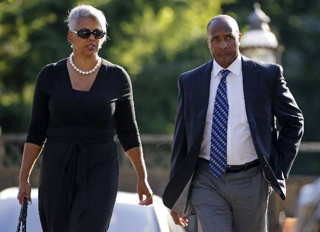 Pittsburgh Steelers Hall of Fame receiver Lynn Swann, right, and his wife Charena, arrive for a viewing for former Steelers coach Chuck Noll in Pittsburgh June 15, 2014. Noll, who led the Steelers to four Super Bowl wins in the 1970's,died this week at the age of 82
