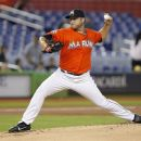 Miami Marlins' Mark Buehrle delivers a pitch during the first inning of a baseball game against the Philadelphia Phillies, Wednesday, Aug. 15, 2012, in Miami. (AP Photo/Wilfredo Lee)