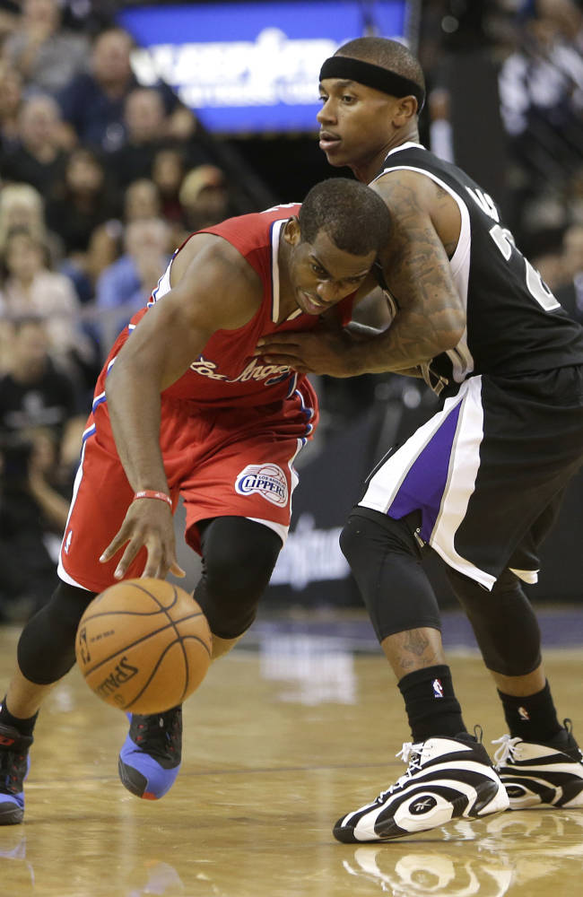 Los Angeles Clippers guard Chris Paul, left, drives against Sacramento Kings guard Isaiah Thomas during the fourth quarter of an NBA basketball game in Sacramento, Calif., Friday, Nov. 1, 2013. The Clippers won 110-101