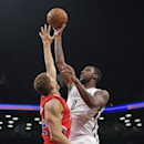Brooklyn Nets center Andray Blatche (0) shoots over Los Angeles Clippers forward Matt Barnes (22) in the first half of their NBA basketball game at the Barclays Center, Thursday, Dec. 12, 2013, in New York The Associated Press