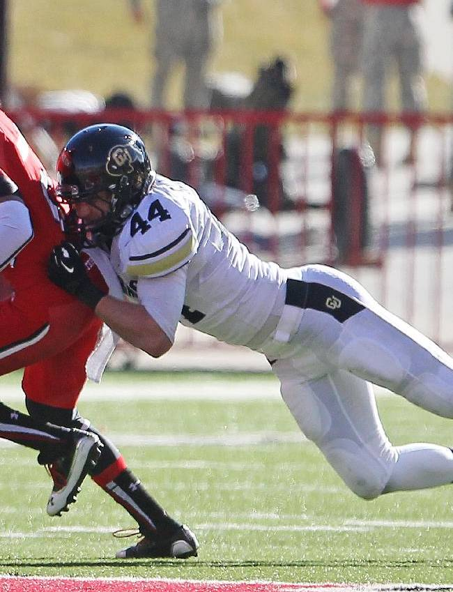 Colorado linebacker Addison Gillam (44) tackles Utah wide receiver Dres Anderson (6) in the second half during an NCAA college football game Saturday, Nov. 30, 2013, in Salt Lake City. Utah won 24-17