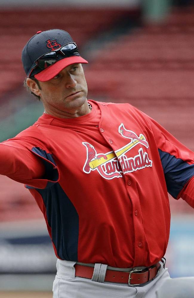 St. Louis Cardinals manager Mike Matheny throws a pitch during batting practice for Game 1 of baseball's World Series against the Boston Red Sox Tuesday, Oct. 22, 2013, in Boston